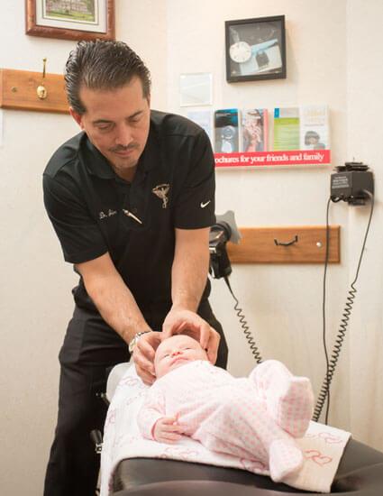 Dr. Jim adjusting baby