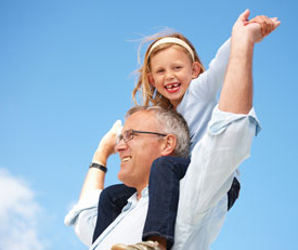 Grandaughter on grandfather's shoulders