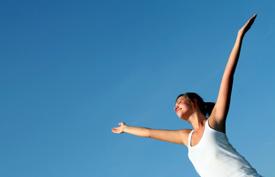 girl-arms-up-blue-sky