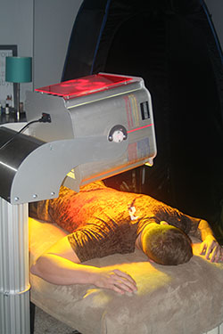 Patient under Near-Infrared Light Therapy (NIR)