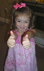 Madison giving two thumbs up