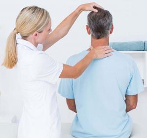 man having his spine adjusted