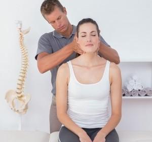 doctor adjusting a womans upper spine