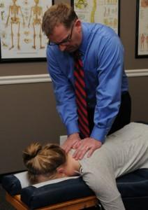 Dr. adjusting a patient