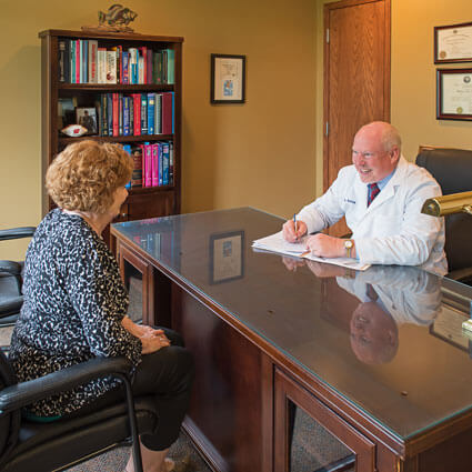 Dr. Kriva consults with a patient