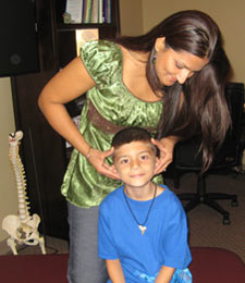 Bee Cave Chiropractor, Dr. Rao adjusting a child.
