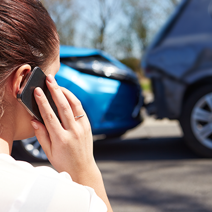 woman on cell phone after car accident
