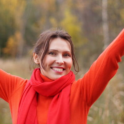 Woman happy arms stretched upward