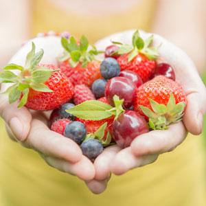 hands holding fruit