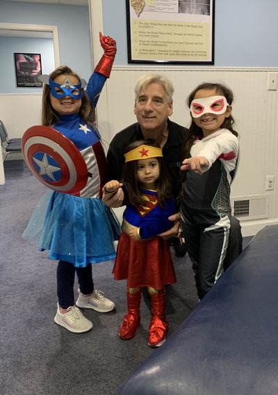 Doctor with costumed kids