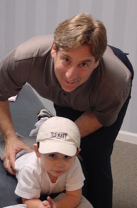 Chiropractor in Rutherford, Dr. George Lubertazzo adjusting a baby
