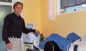 Doctor demonstrates spinal decompression with a patient