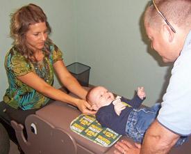 Doctor adjusting a baby