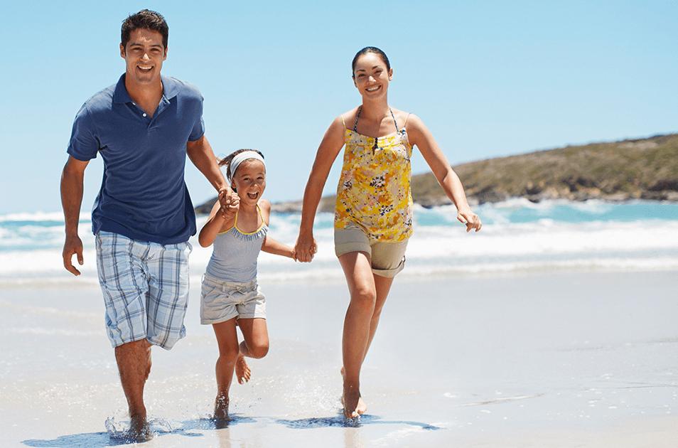 family running on beach