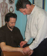 Dr. James Performing Acupuncture.