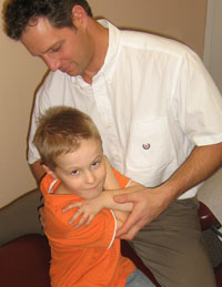 Thunder Bay Chiropractor Dr. James adjusting a young boy