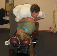 Dr. James Performing A Manual Adjustment.