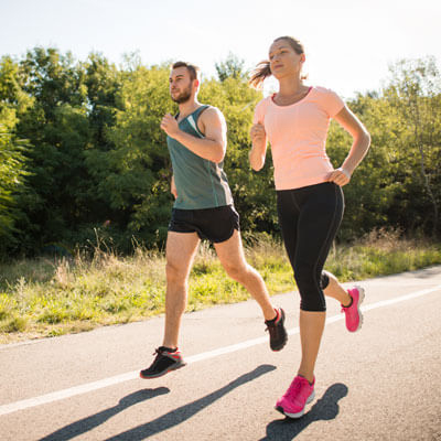 Man and woman jogging on road