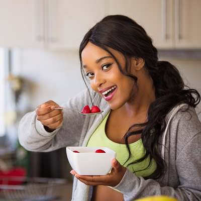 Woman eating healthy raw fruits