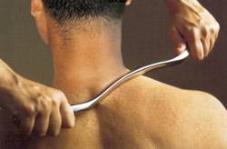 Graston instrument used on a shoulder