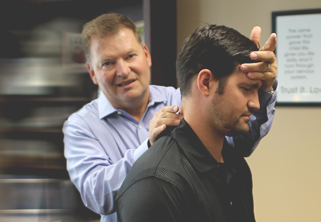 Dr. Stuckey adjusting Neck