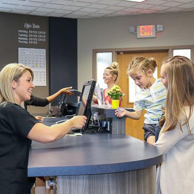 Staff greeting patients
