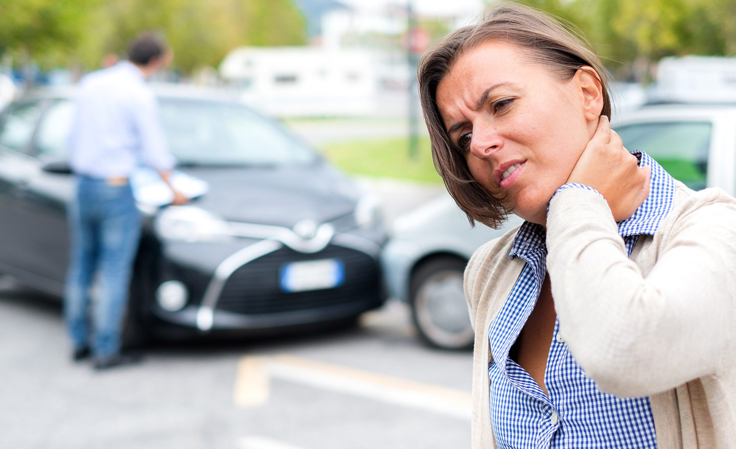woman with sore neck from auto accident