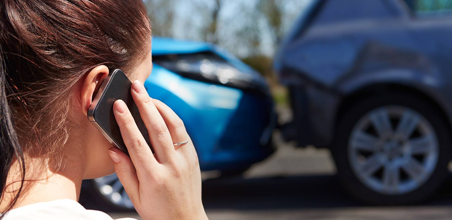 woman on phone after auto accident