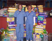 Columbia City Chiropractic staff donating to Diaper Drive