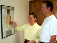 Dr. Lori with a patient explaining how we may help.