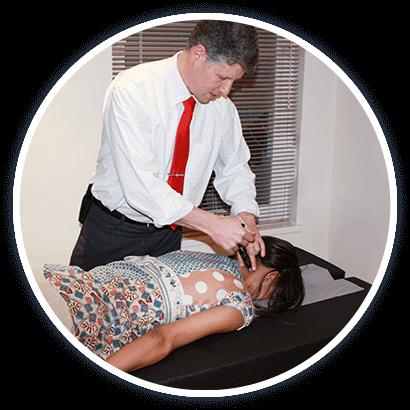 Dr. Reid adjusting woman