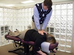 Manual adjusting at Elite Spine Center