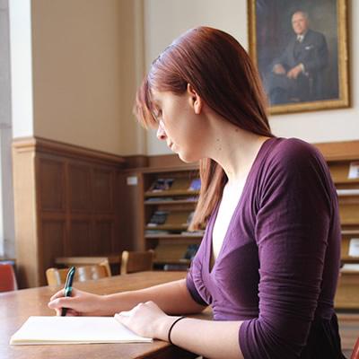 Woman writing on table