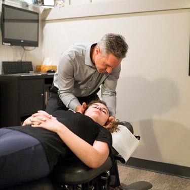 Dr. Michael adjusting woman