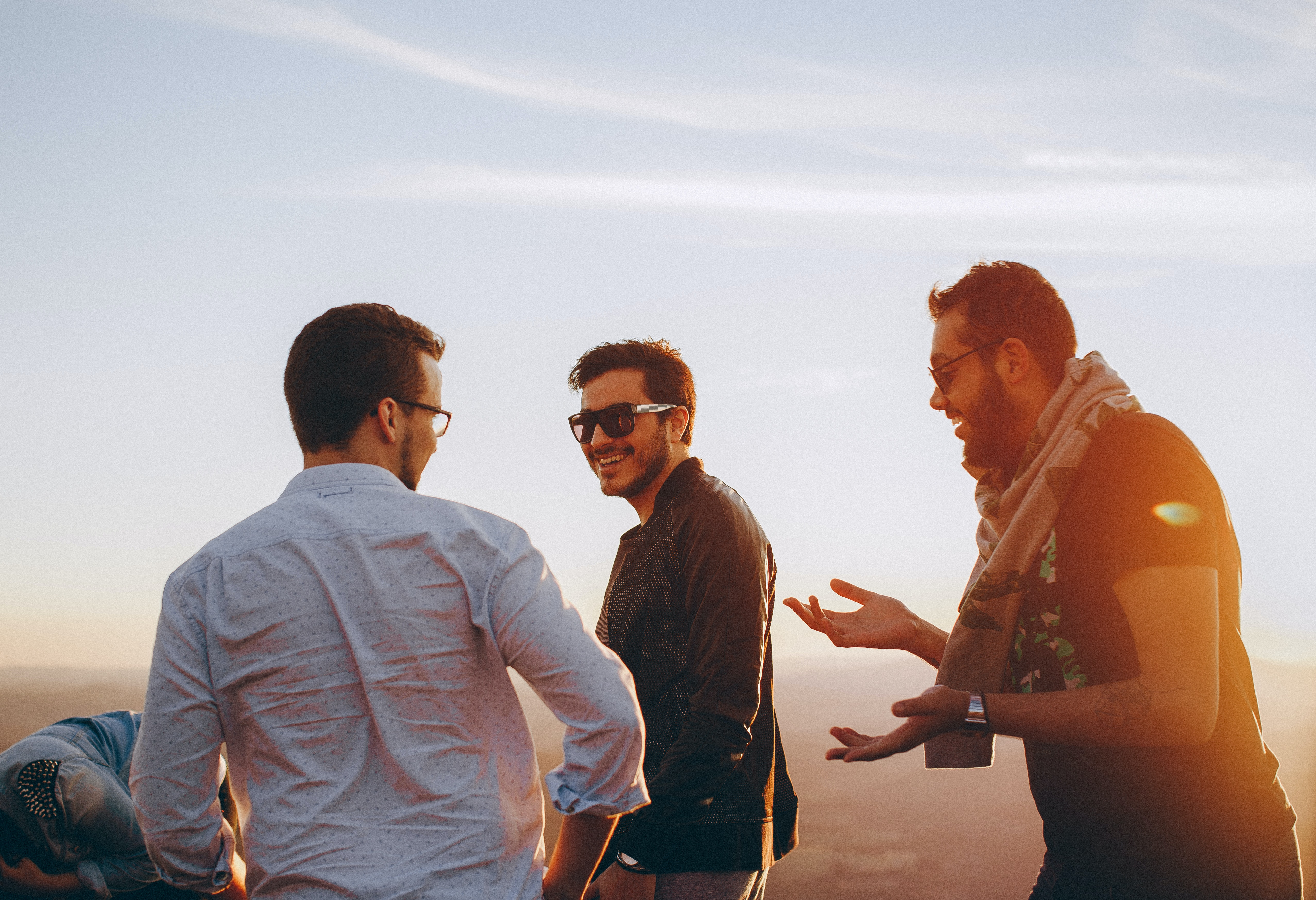 three-men-standing-while-laughing-1049317
