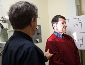 Dr. Dan Fonke performing an X-ray on a patient.