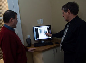 Dr. Dan Fonke explaining what was found in the X-ray.