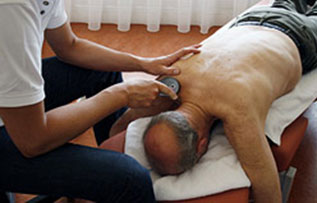 Therapeutic Modalities used on a patients shoulder at {PRACTICE NAME}