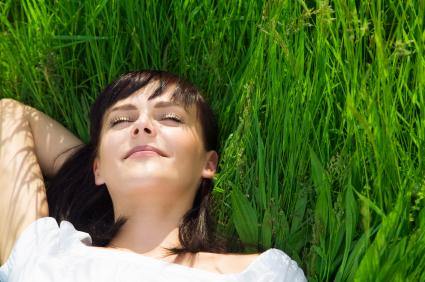 beautiful girl lying down of grass.