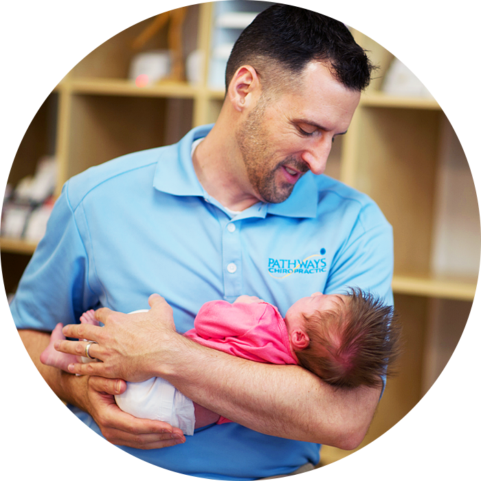 Dr. Dan holding tiny baby