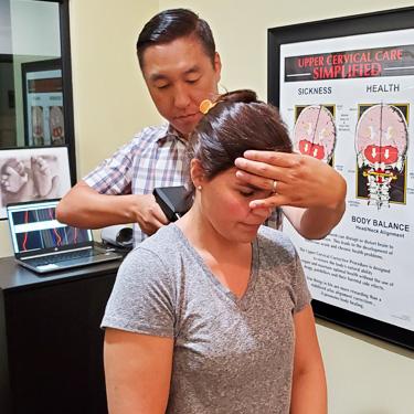 Dr. Lee adjusting patient