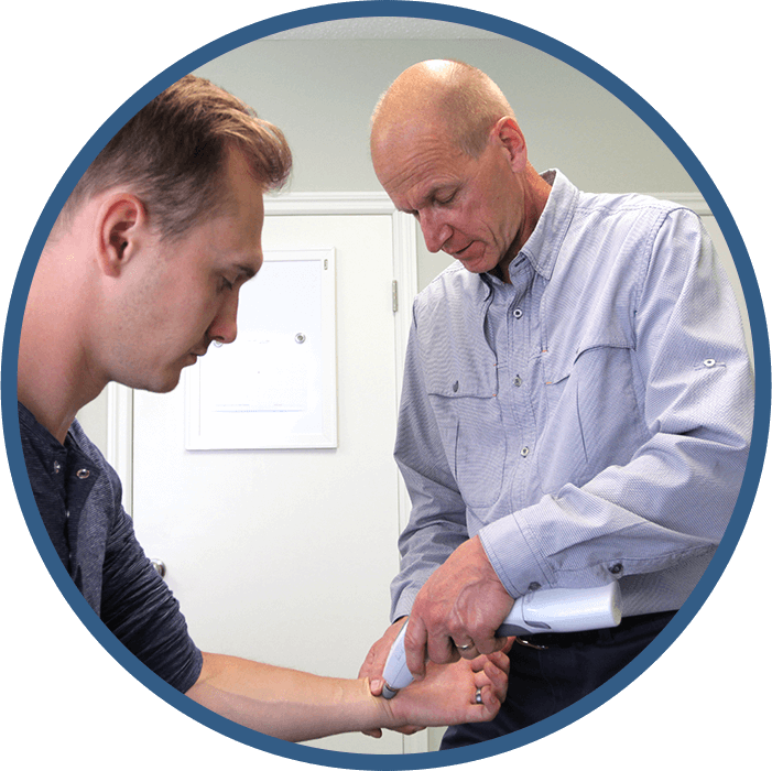 Doctor adjust patient with activator instrument