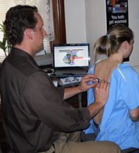 We will perform a rolling thermal scan that will detect subtle skin temperature differences along the spine.