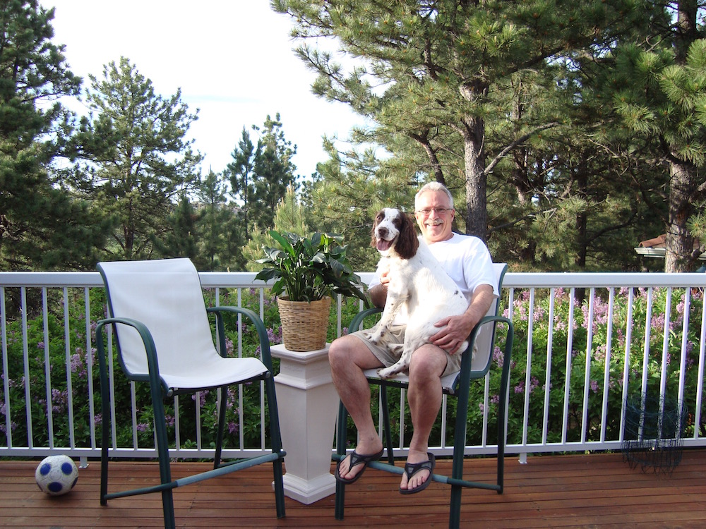 Dr. Jim relaxing on the deck with Skeet