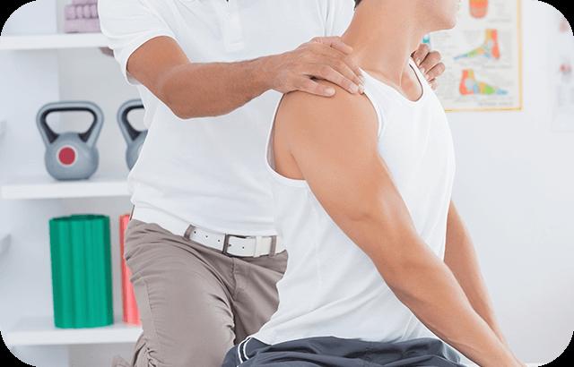 Doctor's hands on man's shoulder