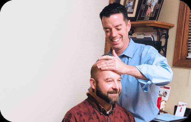 Dr. Kevin adjusting mans neck