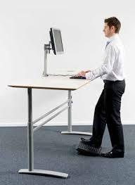 Man Standing at Desk