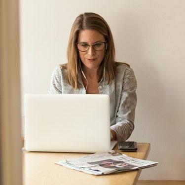 woman-sitting-while-using-laptop