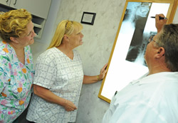Dr. Jones, Cindy, and Alberta are discussing some x-ray results.