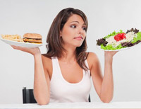 Photo of a woman looking at different types of food.